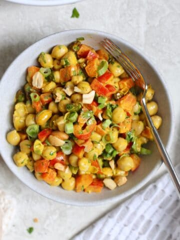 bowl of chickpea salad with spoon
