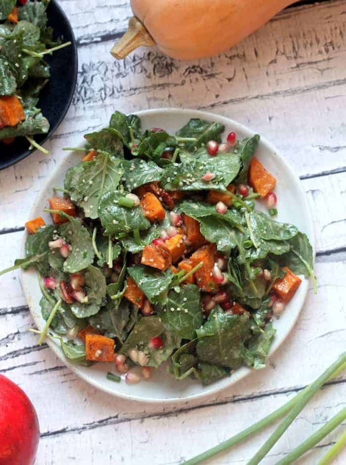 This Healthy Fall Superfood Salad is loaded with roasted butternut squash, pecans, pomegranate, and a creamy orange cinnamon vinaigrette for the perfect autumn meal.