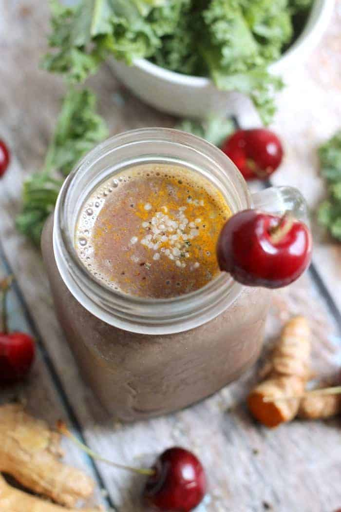 Cherry Pineapple Anti-Inflammatory Smoothie---Packed with superfoods like cherries, hemp seed, ginger, turmeric, and kale, this healthy and delicious smoothie will help keep inflammation at bay!
