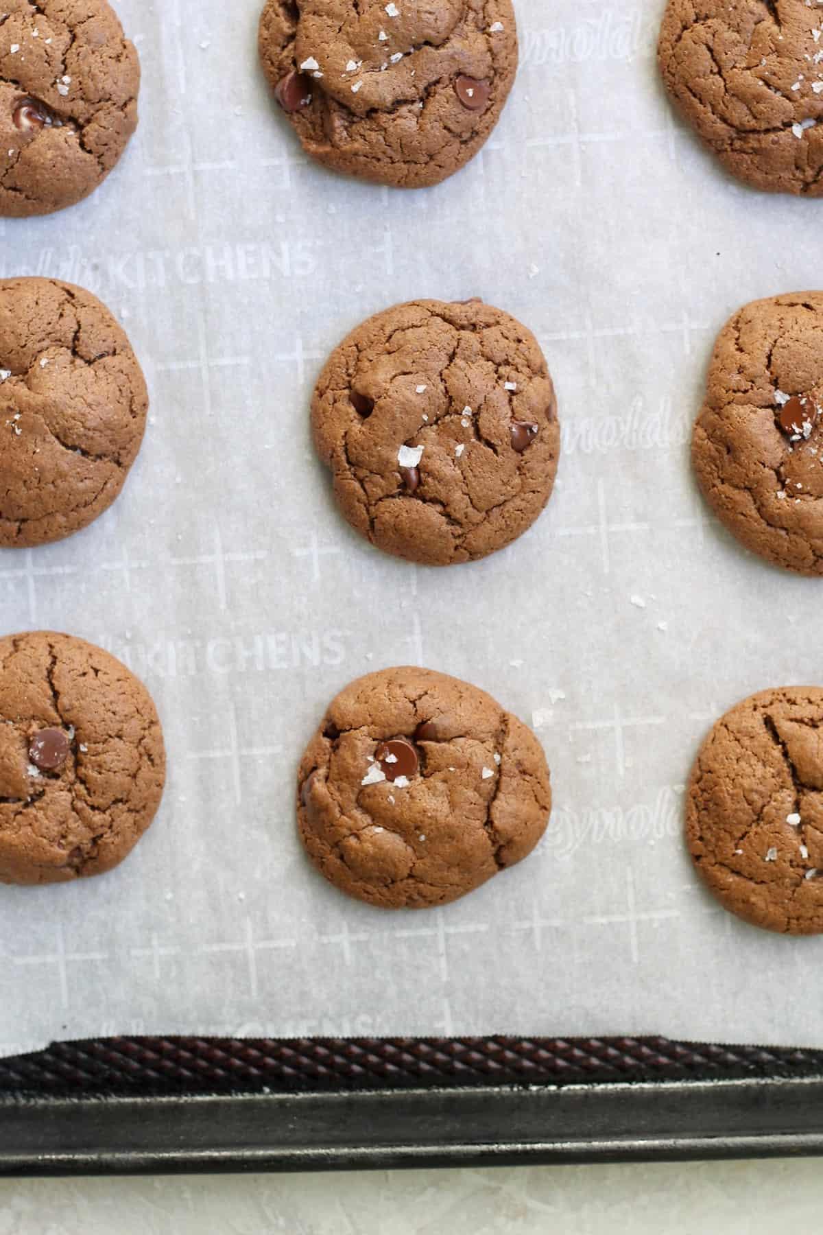 sheet pan of chocolate cookies with salt