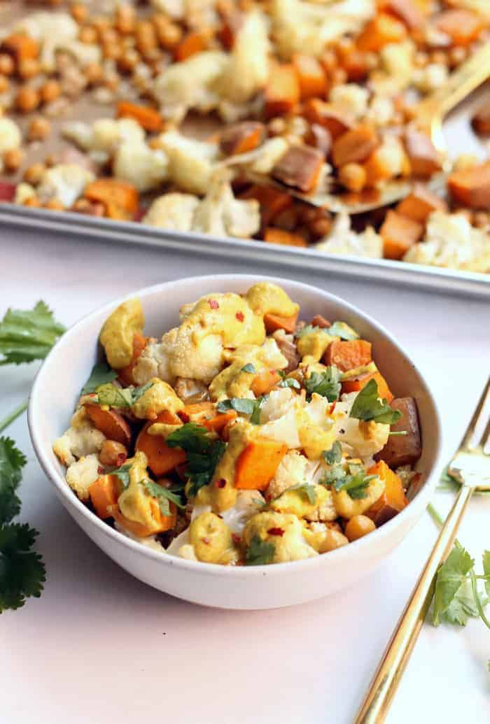 This one pan Curried Cauliflower Chickpea Buddha Bowl is an easy and delicious vegetarian meal, perfect for workweek lunches! Vegan and gluten-free.