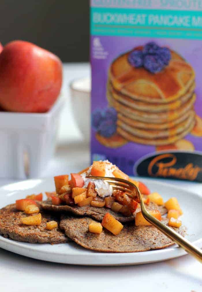 Brighten your morning with these tasty and healthy Vegan Apple Buckwheat Pancakes topped with cinnamon sugar apples! An 100% whole grain, gluten-free and kid-friendly recipe.