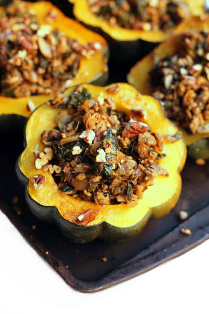 Enjoy this flavorful Tempeh Sausage Stuffed Squash as a healthy meatless meal any night of the week! Vegan, gluten-free, and carnivore-approved!