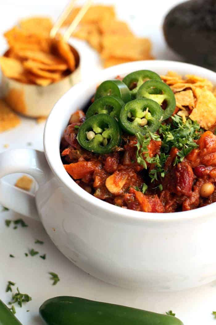 This delicious vegetarian chili is packed with hearty beans, warming spices, and a couple secret ingredients for a super flavorful and healthy meatless meal. Serve with cornbread!