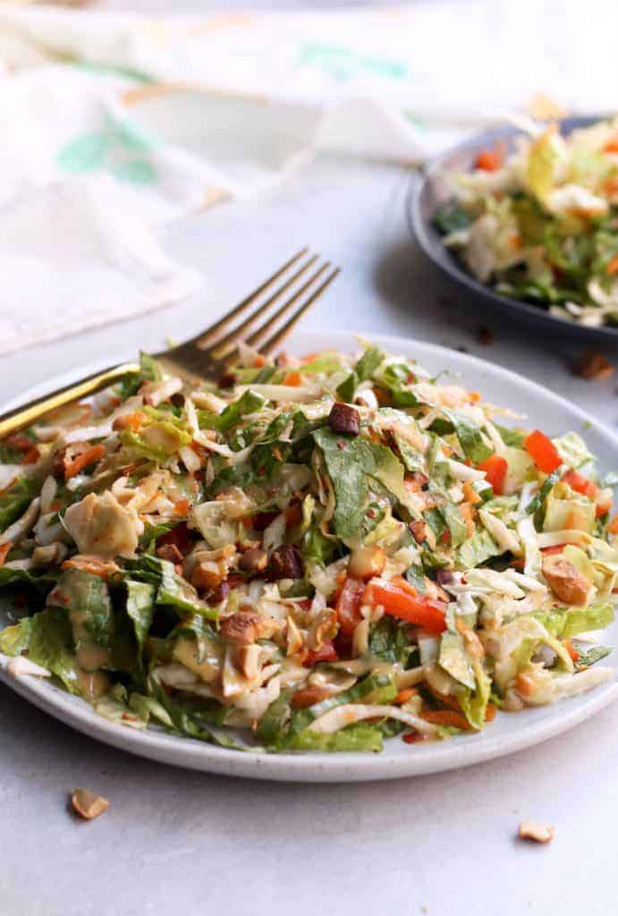 "This tasty Crunchy Thai Salad with Creamy ""Peanut"" Dressing is packed with crisp veggies and a simple allergy-free ""peanut"" sauce that will have everyone begging for seconds! Vegan and gluten-free."