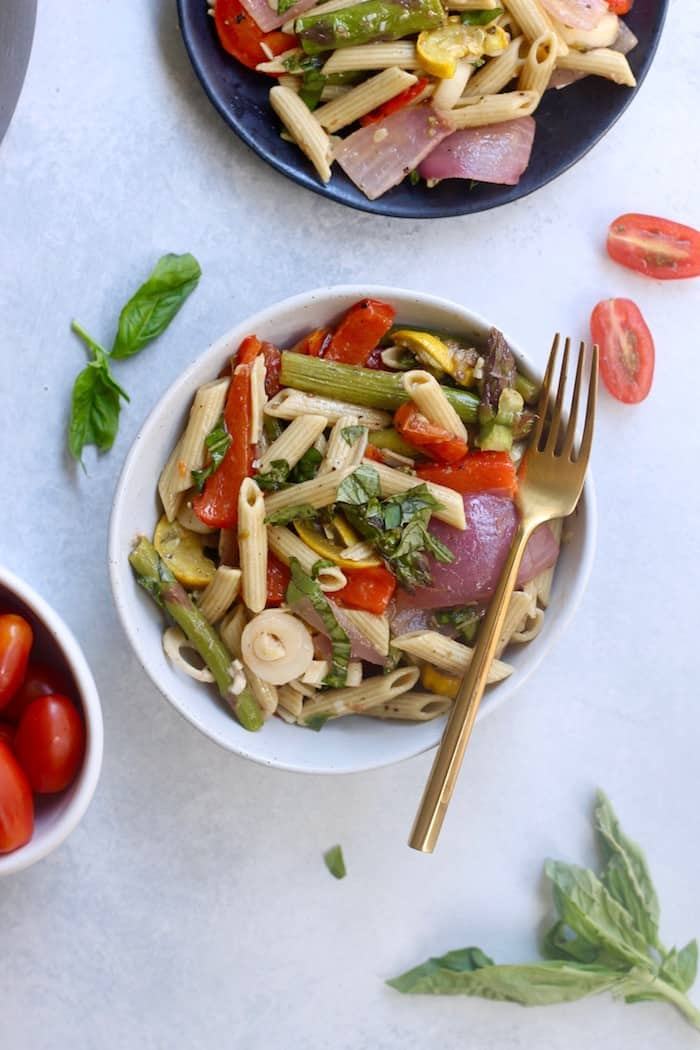 This summery Roasted Veggie Pasta Salad is bursting with fresh flavor for all your outdoor gathering needs! Vegan and gluten-free.