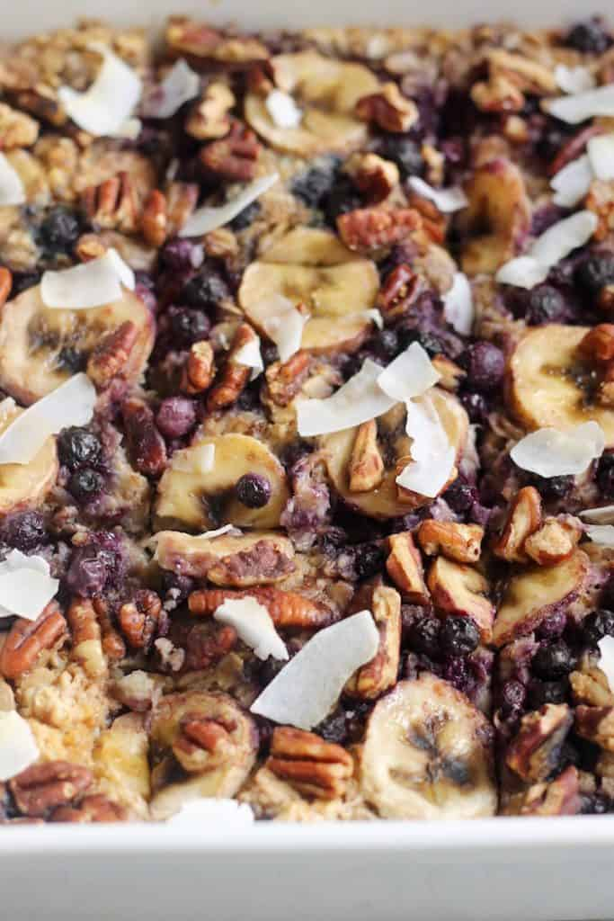 Start your morning with this EASY, sweet, and satisfying Blueberry Banana Nut Baked Oatmeal! It's studded with sweet blueberries, sliced banana, toasted pecans and a dusting of brown sugar. Vegan and gluten-free!