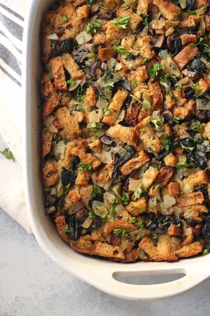 This delicious vegetarian Spinach and Mushroom Herb Stuffing is full of color, texture, and savory flavors that will have the entire family coming back for seconds, meat-eaters and vegetarians alike! It's perfect for Thanksgiving but can be enjoyed any time of year.
