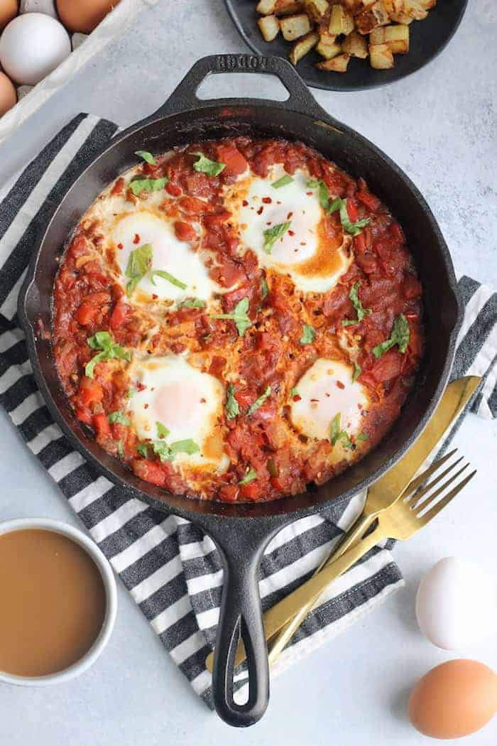The best shakshuka recipe with perfectly spiced tomato sauce, peppers, onions, and eggs. The most epic brunch served with pan-fried potatoes or crusty bread!