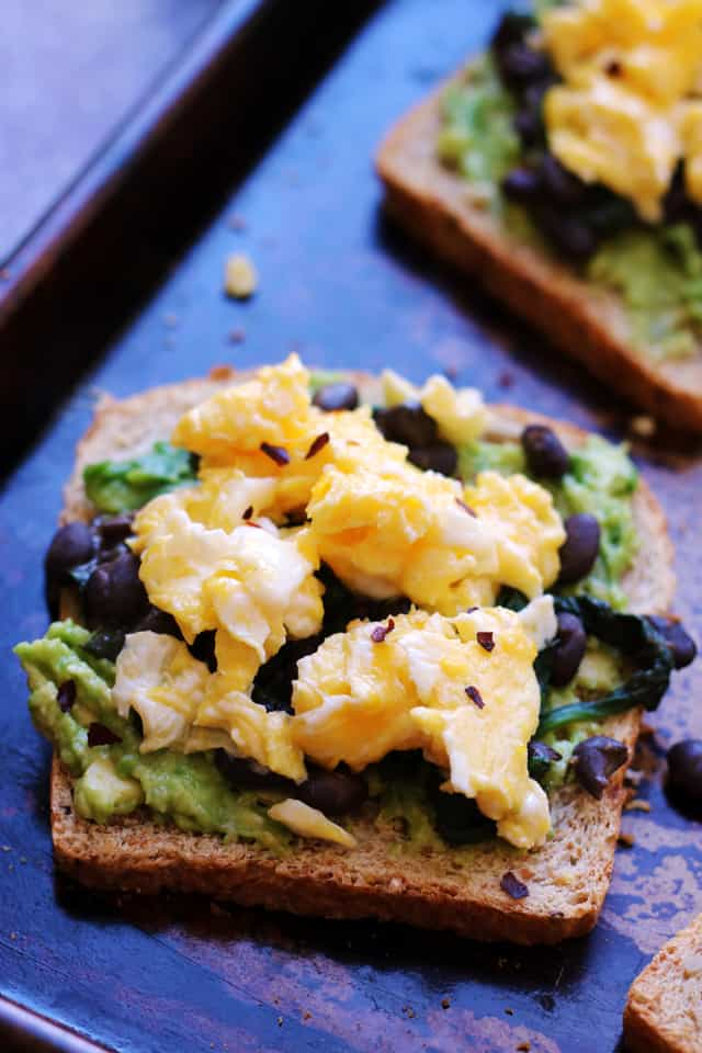 Avocado Toast with Smoky Black Beans, Spinach, and Eggs from Eats Well With Others