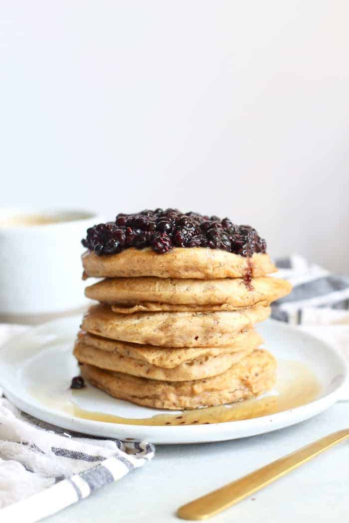 Fluffy Vegan Pancakes with Blueberry Topping make the perfect healthy and tasty breakfast any day of the week. Made with 100% whole grain flour and sweetened with pure maple syrup, you