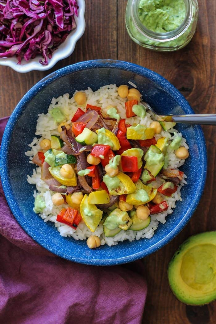 Roasted Summer Vegetable Burrito Bowls with Avocado Basil Crema from The Roasted Root
