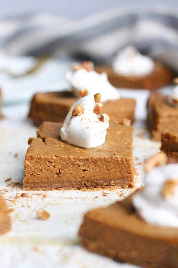These healthy Pumpkin Pie Bars with Pecan Cookie Crust are completely vegan, gluten-free, and are the most delicious easy dessert for the holidays!