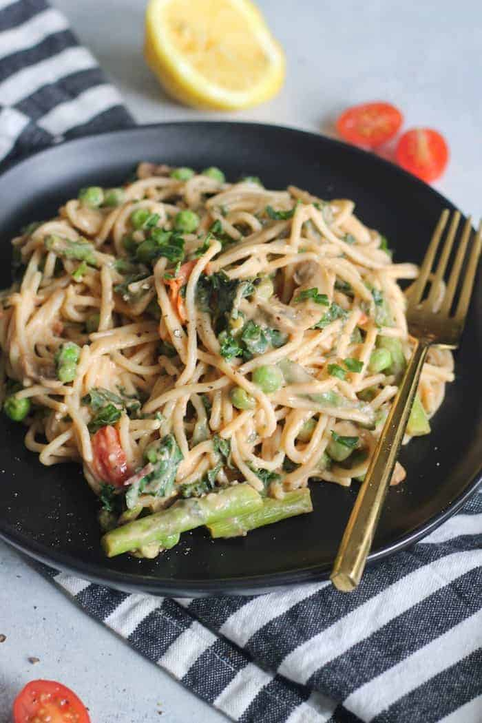 This healthy 30-minute Creamy Spring Vegetable Pasta Primavera made with whole grain spaghetti, loads of fresh veggies and a creamy sauce is the perfect satisfying meal! Vegan and gluten-free option.