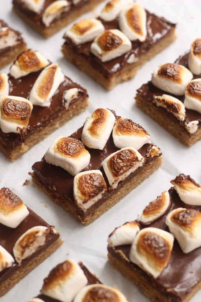 These decadent, easy S'mores Bars are made with whole grain oats and cashew butter for a healthy spin on the Classic! With a rich chocolate layer and gooey marshmallows, kids and adults of all ages will adore these bars! Vegan and gluten-free option.