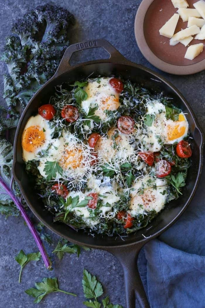 Tomato, Kale and Parmesan Baked Eggs from The Roasted Root