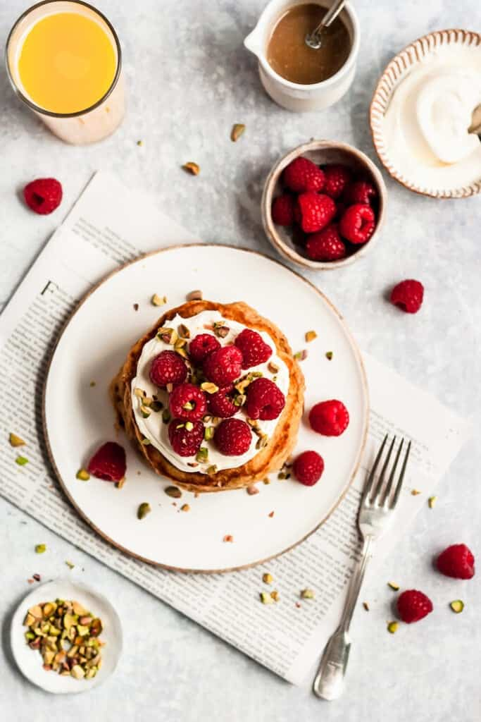 orange pancakes stack with raspberries