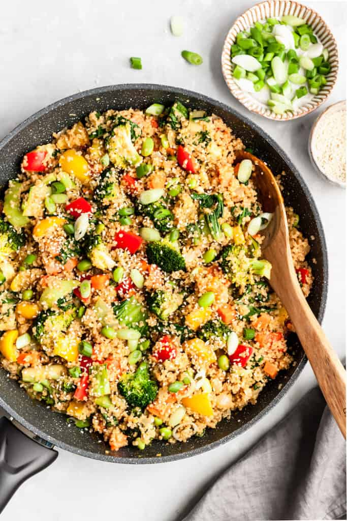 This crowd-pleasing Quinoa Veggie Stir Fry with Peanut Sauce is a super flavorful plant-powered meal the whole family will love! Vegan and gluten-free.