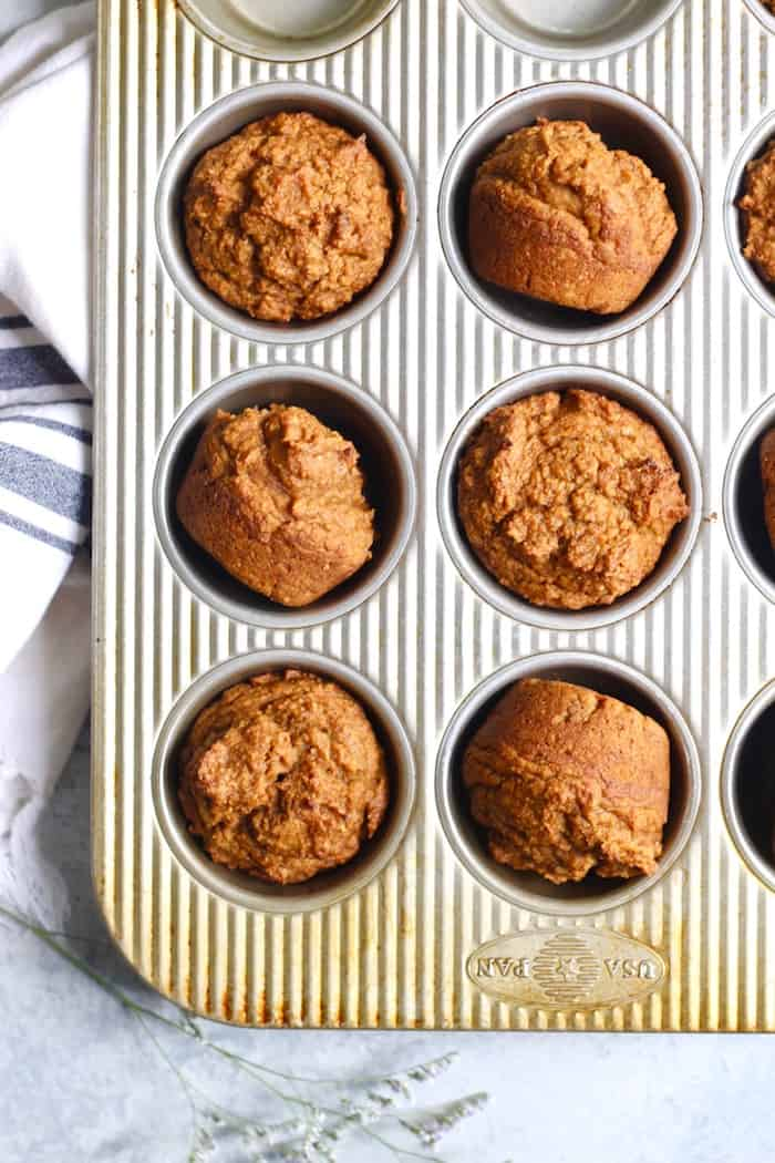 muffin tin of vegan pumpkin muffins