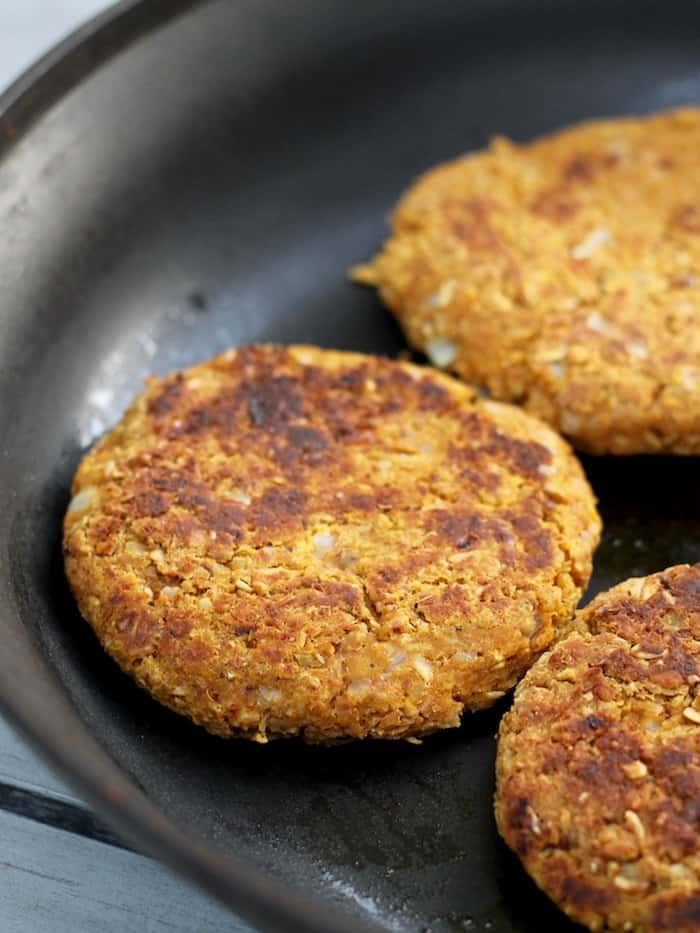 Hearty plant-powered Pumpkin Walnut Veggie Burgers with Chipotle Yogurt Sauce. Bursting with flavor and ready in under 30 minutes!
