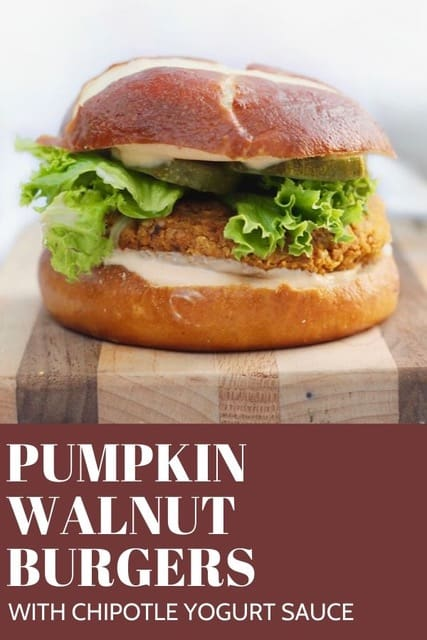 burger on wood board with pumpkin and walnuts