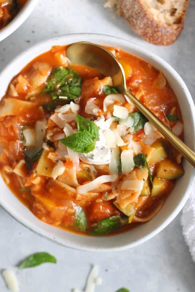 The most delicious and comforting deconstructed Vegan Lasagna Soup packed with veggies! This healthy and cozy one-bowl-meal is easily gluten-free and on the table in thirty minutes!