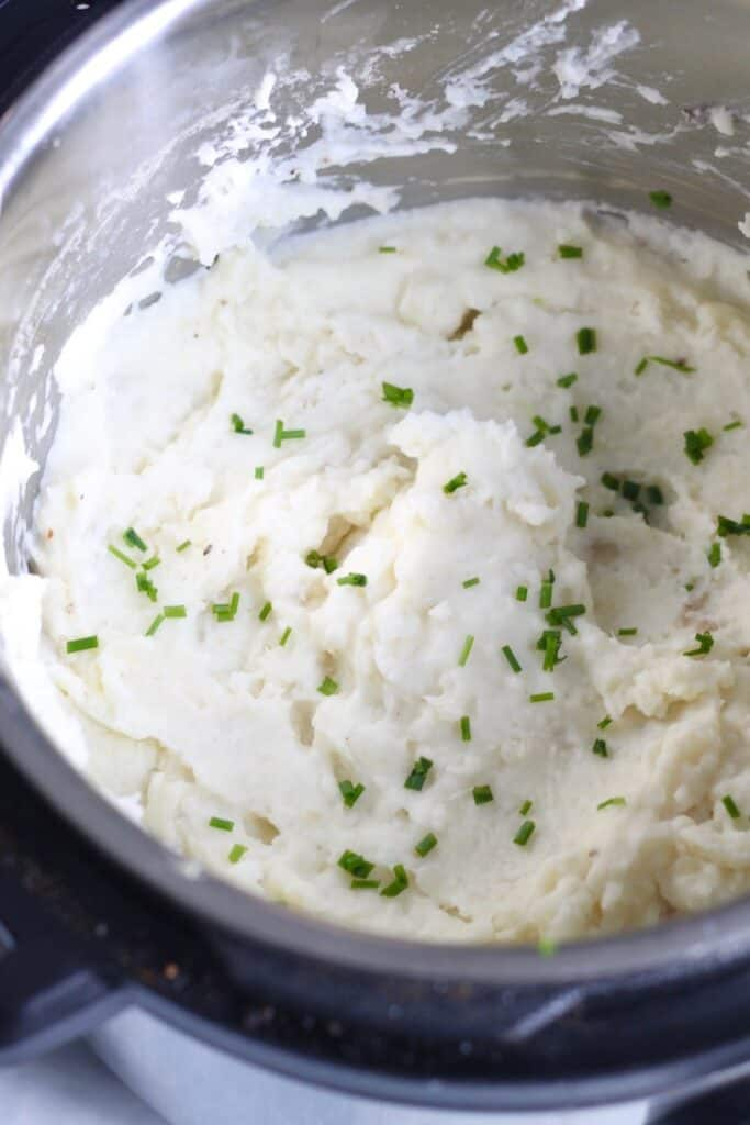 Instant Pot Mashed Potatoes with garlic and cream cheese are super creamy and rich yet so easy to make! Done in 20 minutes, they make the perfect holiday side dish.