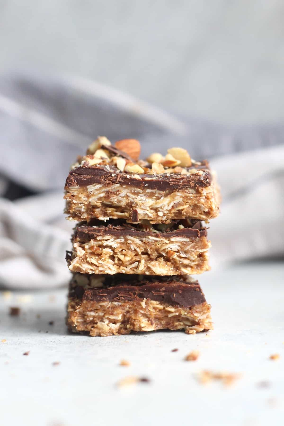 three chocolate almond butter bars stacked