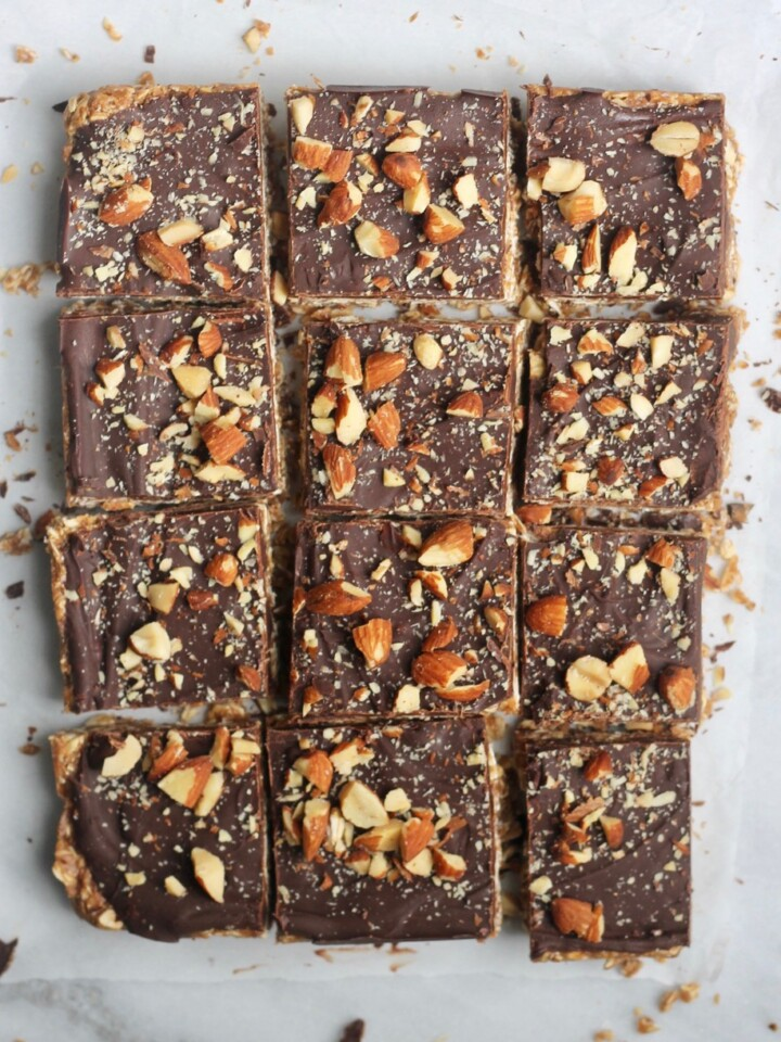 cut chocolate almond butter bars on parchment paper