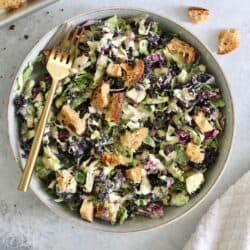 This Vegan Brussels Sprout and Kale Caesar Salad is healthy spin on the classic with crisp Brussels sprouts, crunchy homemade rosemary croutons and a delicious dairy-free cashew caesar dressing. Great for a crowd!