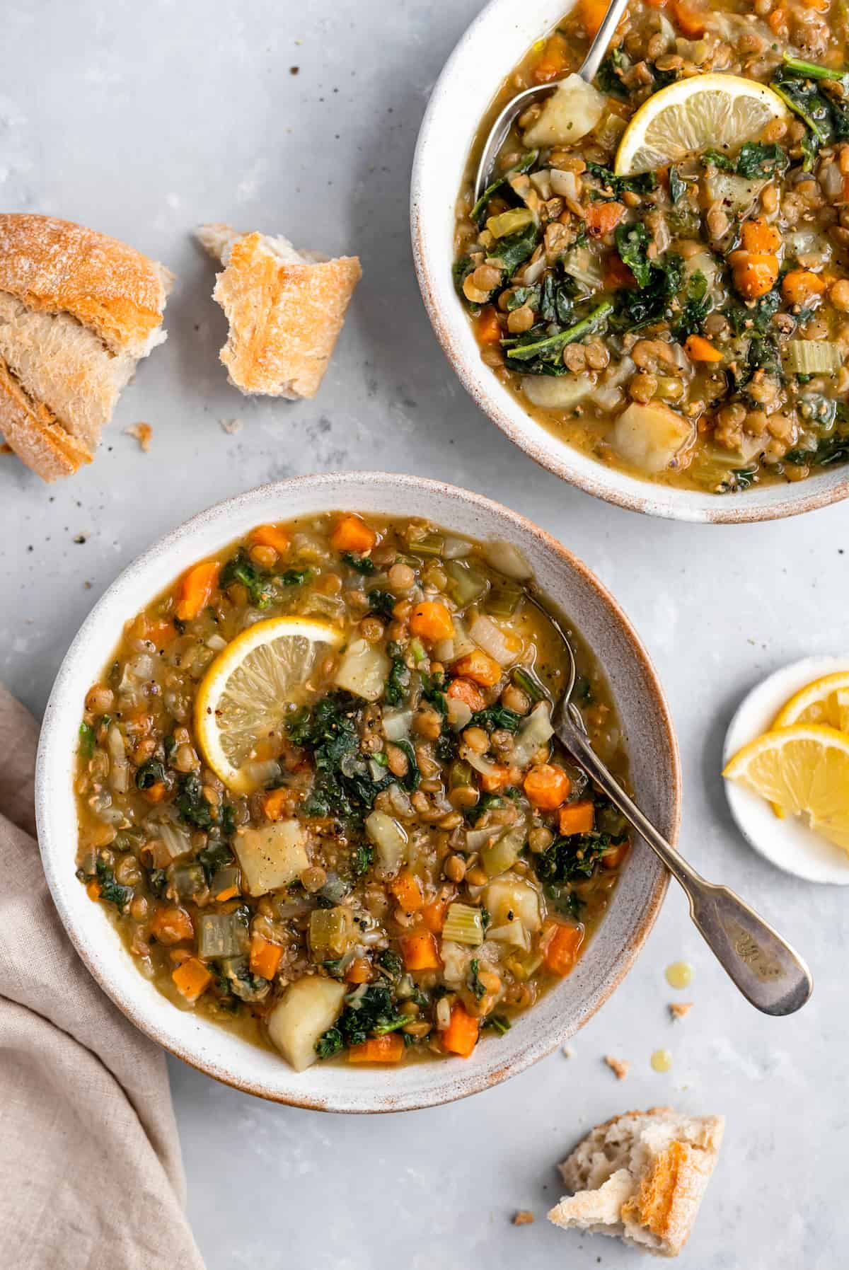 two bowls of lentil soup with lemon