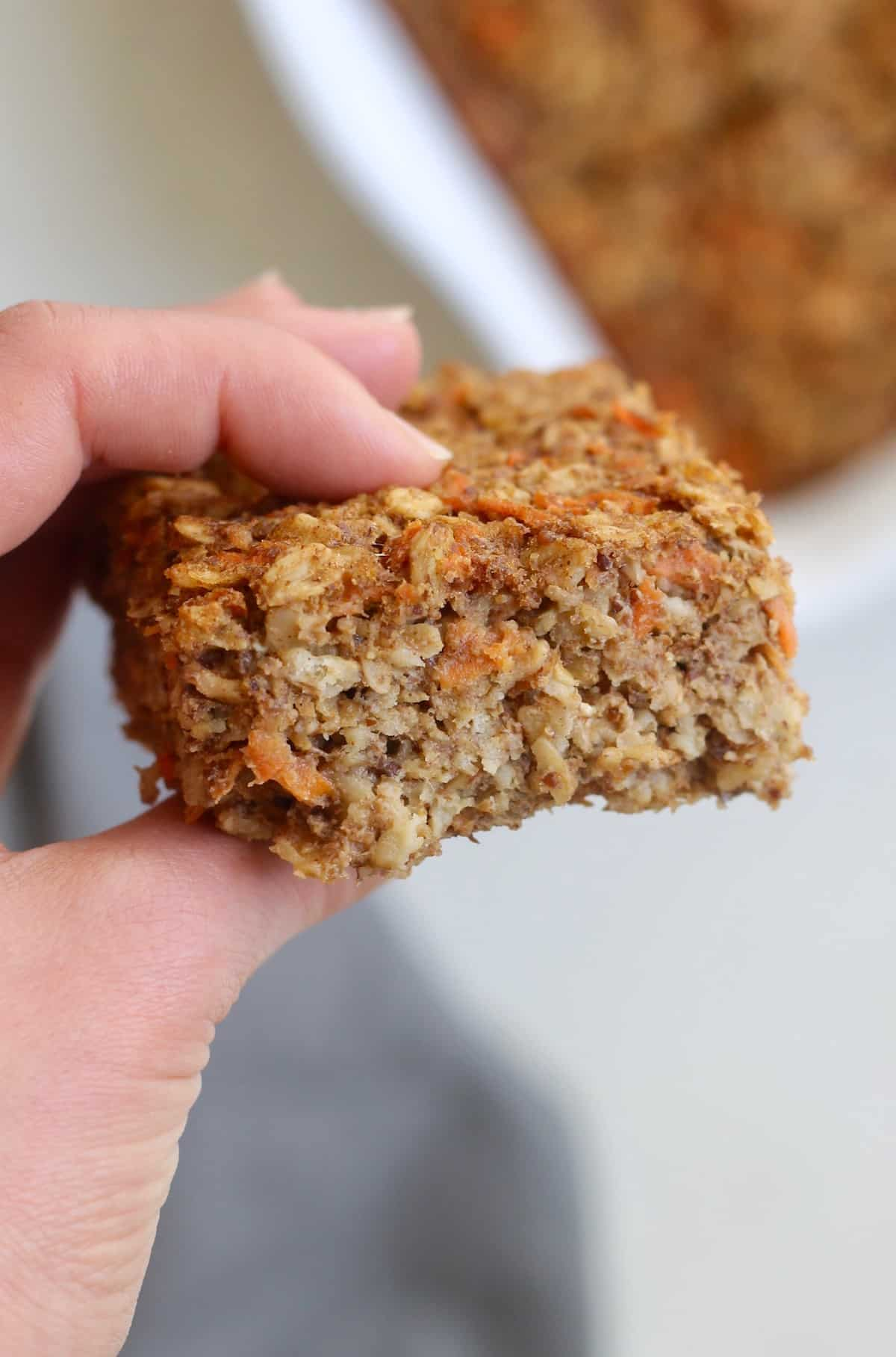 up close carrot cake baked oatmeal bar hand held