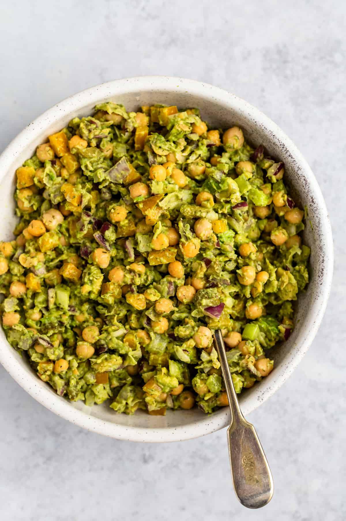white bowl of chickpea salad with spoon