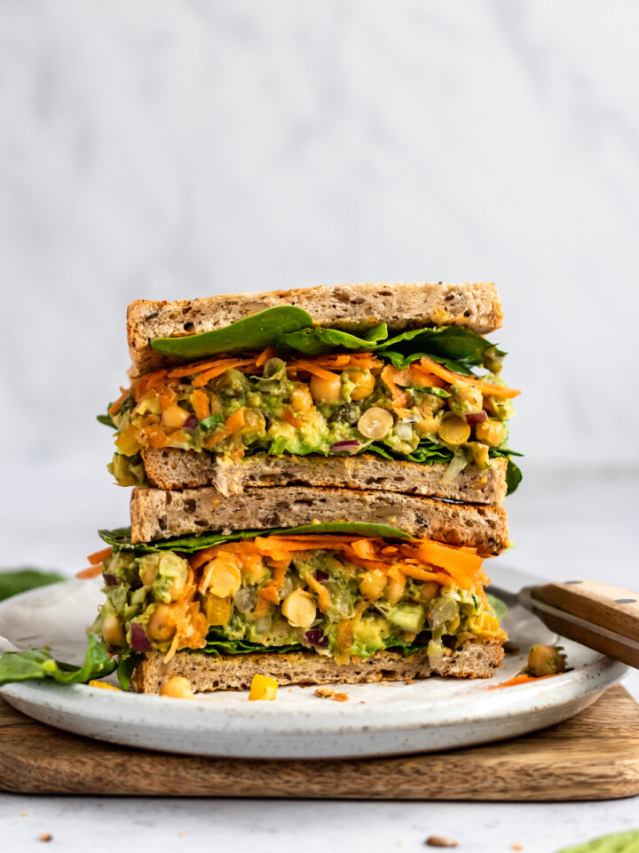 chickpea sandwich on white plate with knife