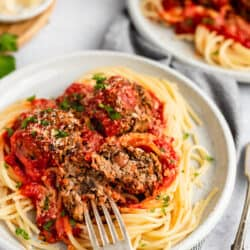 plate of vegan meatballs with fork