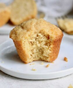 orange muffin on small white plate
