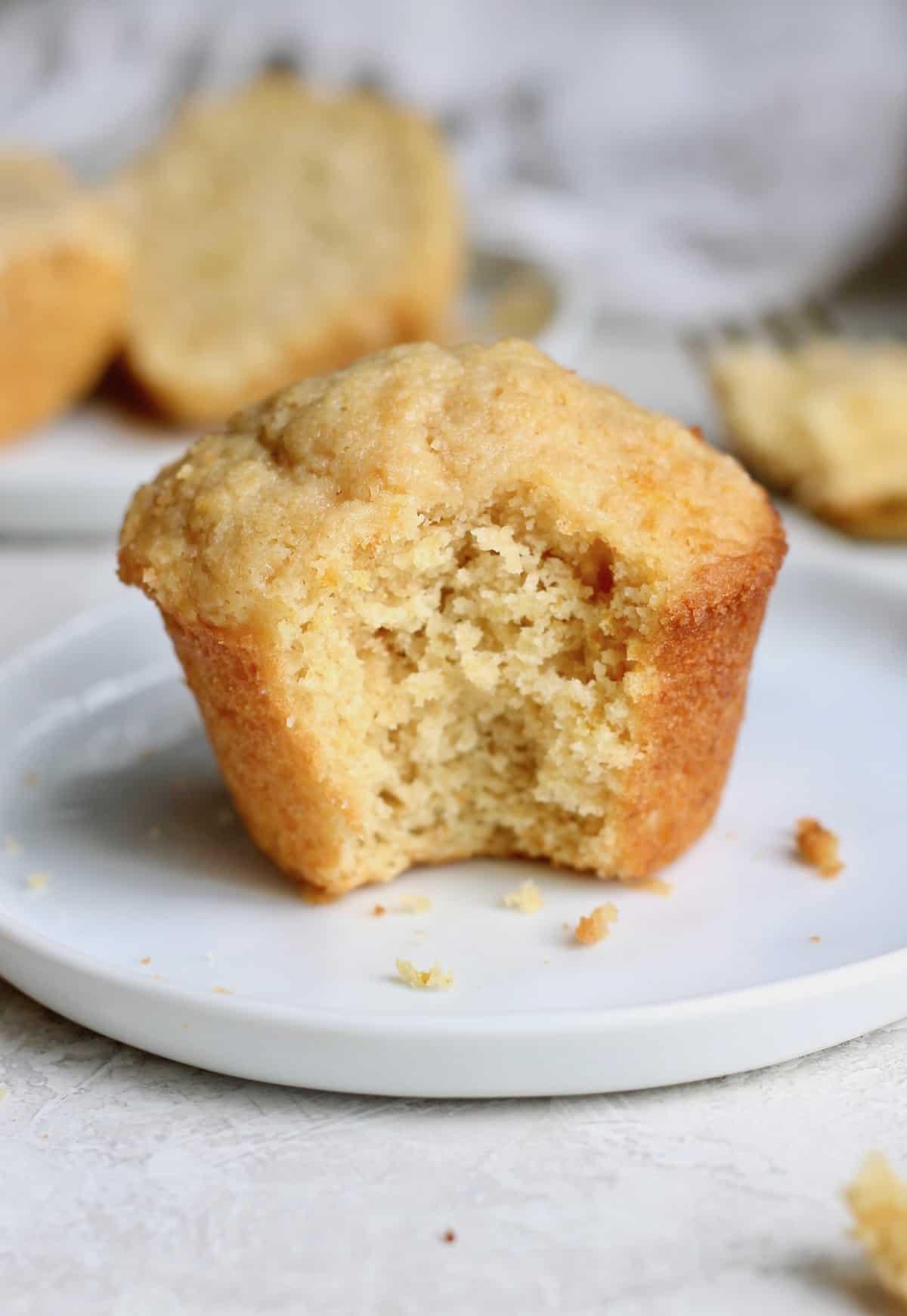 orange muffin on small white plate