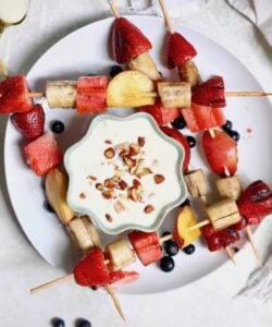 fruit skewers on plate