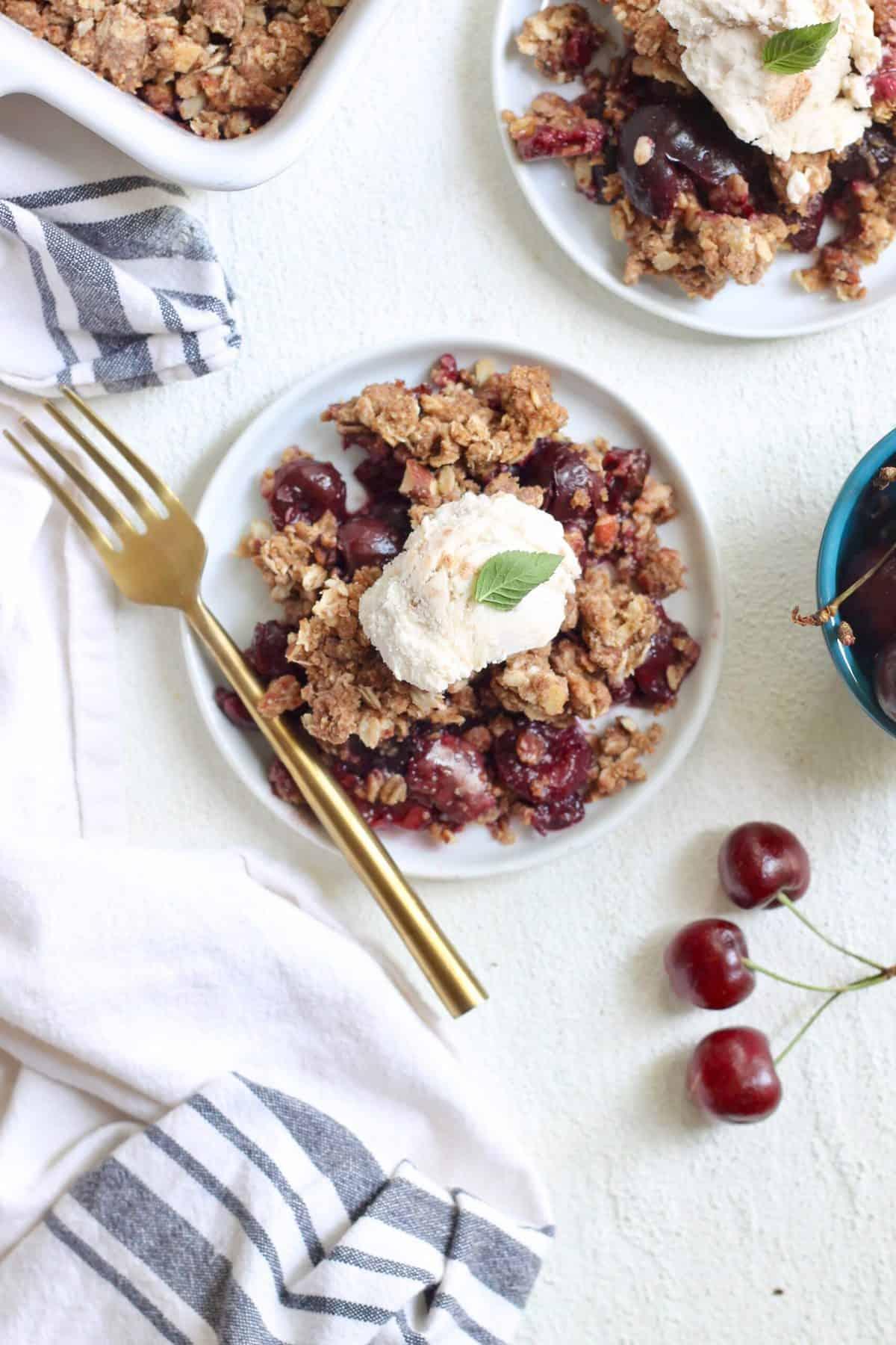 cherry crisp with dish towel and three cherries