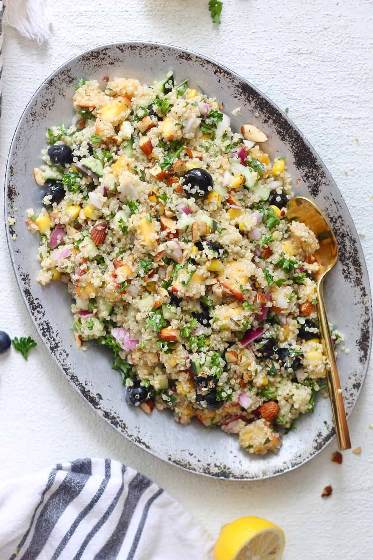 silver dish of colorful quinoa salad