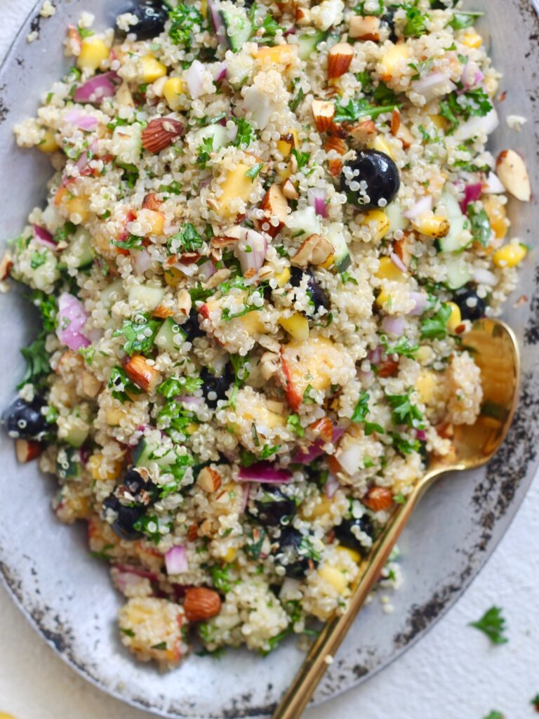 colorful quinoa salad with gold spoon