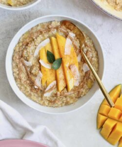 bowl of oatmeal with gold spoon