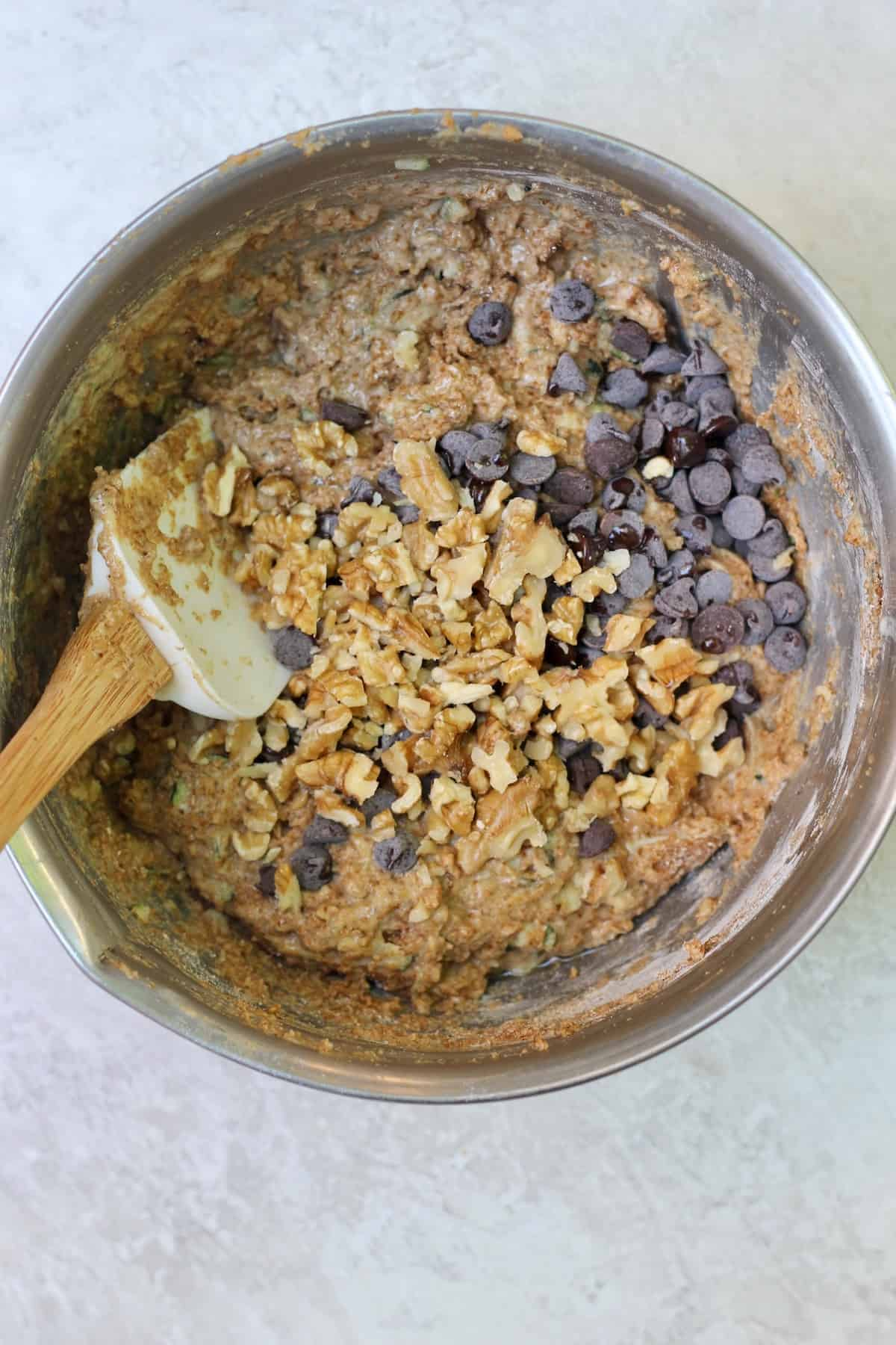 bowl of batter with walnuts and chocolate chips