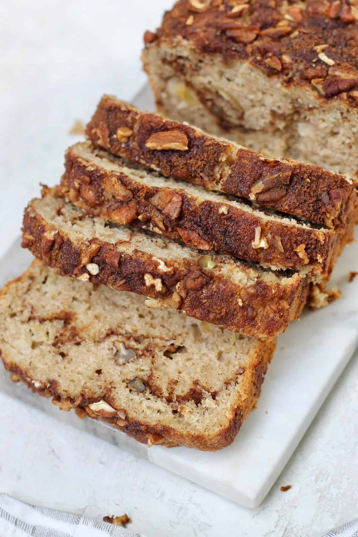 sliced apple cinnamon loaf with pecans
