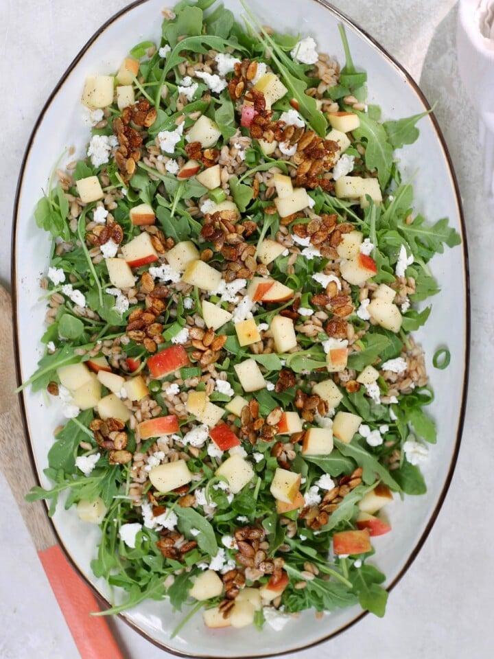 serving platter of arugula salad with apple