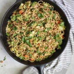 cast iron skillet with noodles and veggies