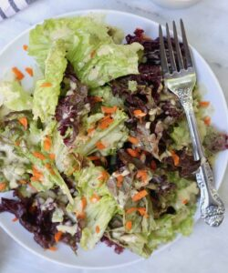 salad on a plate with fork