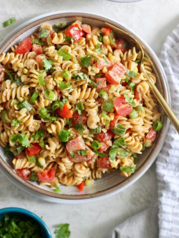 bowl of pasta salad with gold fork