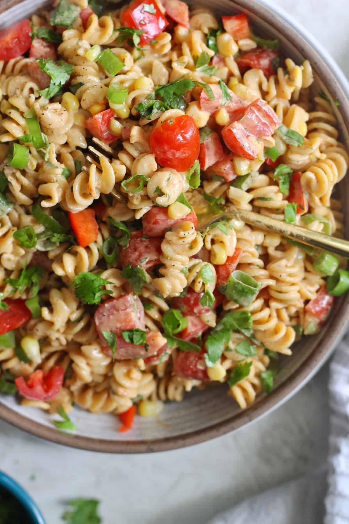 bowl of pasta salad with vegetables