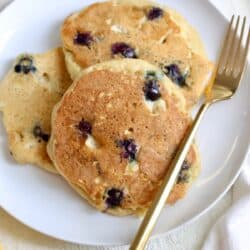 plate of lemon blueberry pancakes with fork